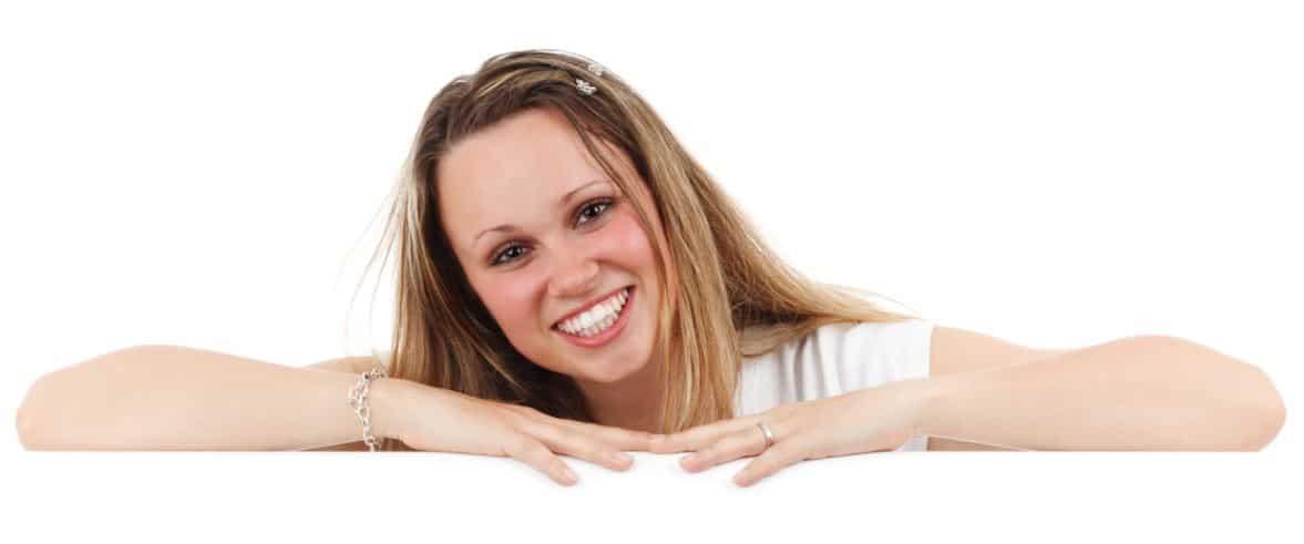 Model in white smiling